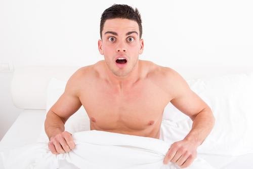 surprised-and-shocked-half-naked-young-man-bed-looking-down-his-penis (1)
